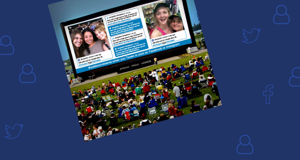 Out screen with audience, displaying social media posts and photos